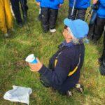 Dawn, explaining grasses, on Skye